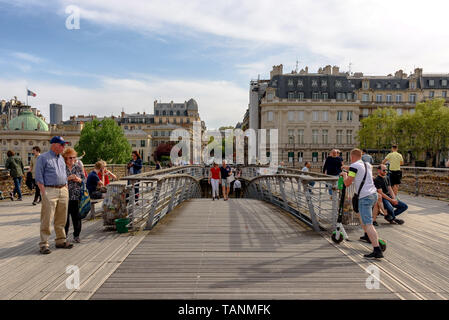 People walking on the Passerelle Léopold-Sédar-Senghor in Paris, France on a sunny day - Stock Photo