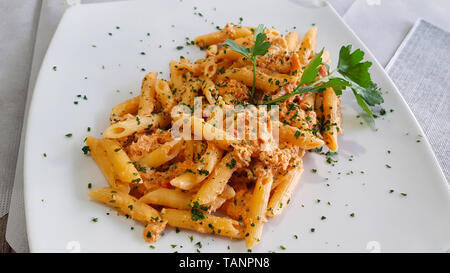 Pasta with crab meat. Penne with crab meat is a light fish dish. Italian cuisine - Stock Photo