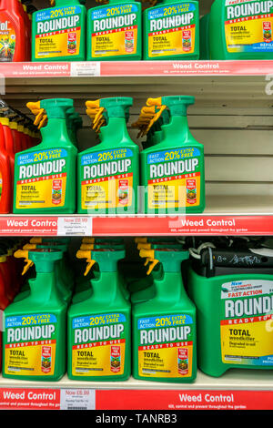 Spray bottles of Roundup weedkiller on sale in a garden centre. - Stock Photo