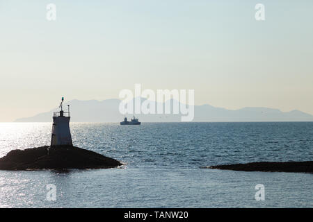 Looking across to the Isle of Rum from the port of mallaig Highland Scotland - Stock Photo