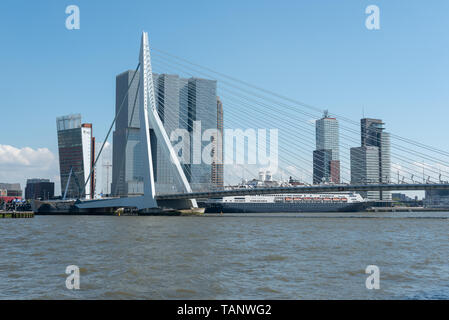 Rotterdam, Netherlands - May 11, 2019 : Skyline view from the new Meuse river borders with Erasmus bridge and De Rotterdam buildings in the background on a clear day - Stock Photo