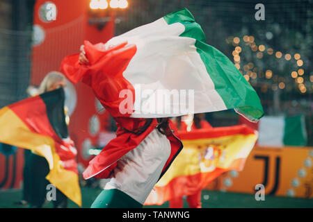Flags Italy, Germany, Spain during a sports soccer match at a stadium in smoke