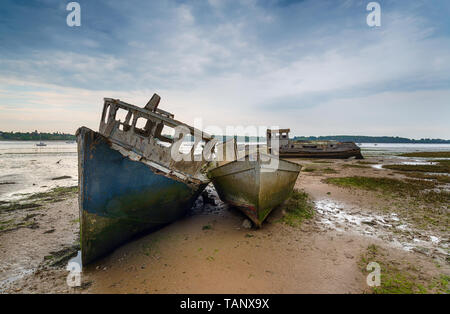 Old wrecked boats on the River Orwell at Pin Mill near Ipswich on the Suffolk coastline - Stock Photo