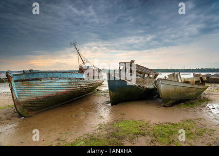 Old abandoned fishing boats on the River Orwell estuary at pin Mill on the coast of Suffolk - Stock Photo