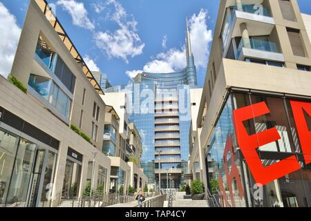 Milan, Italy - July 15, 2016: Panoramic view to the Milan Porta Nuova business centre shopping mall with Unicredit tower in a happy sunny summer day. - Stock Photo