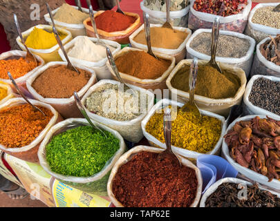 Sacks of spices, herbs and curry powders on display at Anjuna Beach Flea Market, Goa, India - Stock Photo