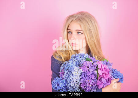 Simple beauty. Girl cute blonde hug hydrangea flowers bouquet. Natural beauty concept. Skin care and beauty treatment. Gentle delicate flower. Pure beauty. Tenderness of young skin. Springtime bloom. - Stock Photo