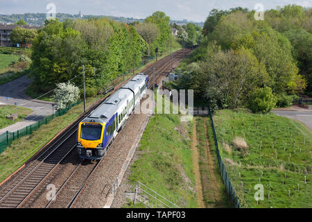 A brand new Northern Rail CAF class 195 diesel train on the west coast main line with a driver training run - Stock Photo