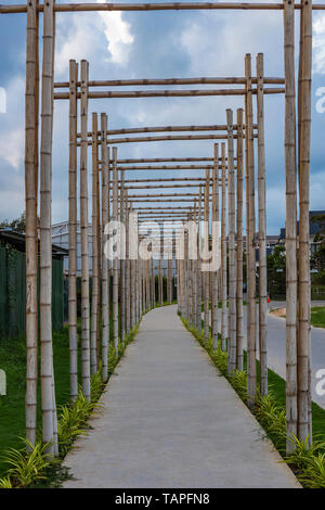 A pathway with bamboo gates in Phu Quoc, Vietnam - Stock Photo