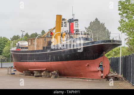 Irvine, Scotland, UK - May 25, 2019: Irvine Harbour Maritime Museum North Ayrshire Scotland Looking Over some ancient maritime puffers that are berthe - Stock Photo
