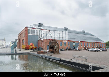 Irvine, Scotland, UK - May 25, 2019: Irvine Harbour Maritime Museum North Ayrshire Scotland Looking Over some ancient maritime machinery  that are on  - Stock Photo