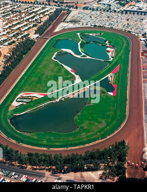 This historical 1974 aerial photograph shows the now-demolished Hollywood Park Racetrack that was famous for 75 years as the place for thoroughbred horse racing in Los Angeles County, California, USA. The track opened in Inglewood in 1938 and closed at the end of the 2013 race season. The 298-acre (121-hectare) site is being transformed into a residential, entertainment and sports center that features the new 70,000-seat Los Angeles Statium. Home games of two National Football League (NFL) teams, Los Angeles Chargers and Los Angeles Rams, will be played there, as will the Super Bowl in 2022. - Stock Photo