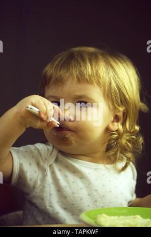 Little boy eating - Stock Photo