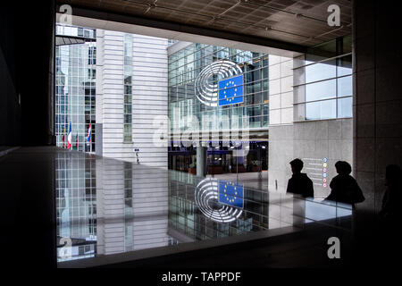 26 May 2019, Belgium, Brüssel: An entrance to the European Parliament is reflected in a glass surface. From 23 May to 26 May, the citizens of 28 EU states will elect a new parliament. Photo: Marcel Kusch/dpa