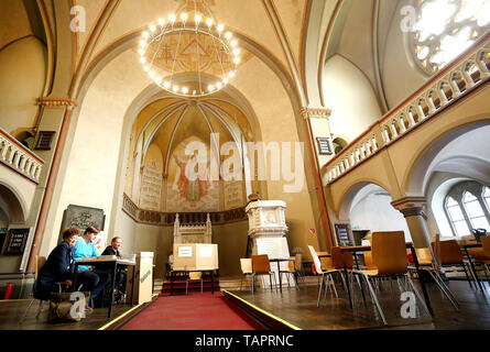 Bochum, Germany. 26th May, 2019. In the Luther Church, which is no longer used as a church, the city of Bochum has set up a polling station. From 23.05. to 26.05.2019 the citizens of 28 EU states elect a new parliament. Credit: Roland Weihrauch/dpa/Alamy Live News - Stock Photo