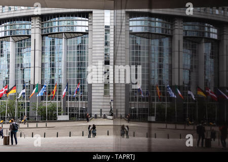 26 May 2019, Belgium, Brüssel: An entrance to the European Parliament is reflected in a glass façade. From 23 May to 26 May, the citizens of 28 EU states will elect a new parliament. Photo: Marcel Kusch/dpa