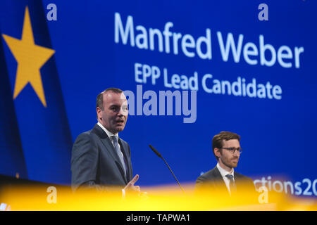 Brussels, Belgium. 27th May 2019. Manfred Weber (L), leader of the center-right European People's Party (EPP) group, speaks at the European Parliament in Brussels, Belgium, May 27, 2019. Voters in Germany, Lithuania, Cyprus, Bulgaria, Greece and Italy cast their ballots on Sunday in elections to the European Parliament (EP). Credit: Xinhua/Alamy Live News - Stock Photo