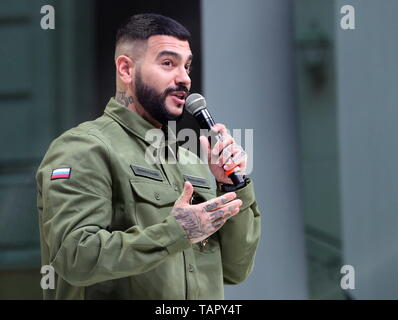 Moscow, Russia. 27th May, 2019. MOSCOW, RUSSIA - MAY 27, 2019: Black Star Inc CEO Timur Yunusov (Timati) speaks at a fashion show held at the Russian National Defence Management Centre for his new fashion collection designed jointly with the Voentorg suplus chain store. Sergei Savostyanov/TASS Credit: ITAR-TASS News Agency/Alamy Live News - Stock Photo