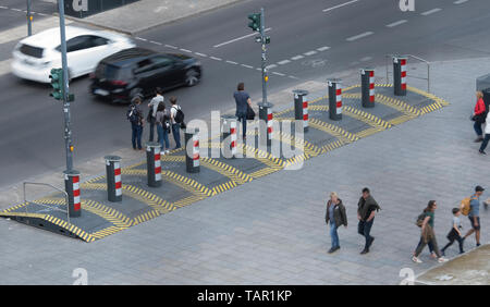 Berlin, Germany. 27th Apr, 2019. Passers-by walk over safety barriers at the Breitscheidplatz. Credit: Paul Zinken/dpa/Alamy Live News - Stock Photo