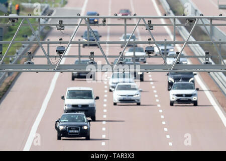 Thurland, Germany. 12th May, 2019. Various cars and vans drive under a toll bridge on the A9 motorway. Credit: Jan Woitas/dpa-Zentralbild/dpa/Alamy Live News - Stock Photo
