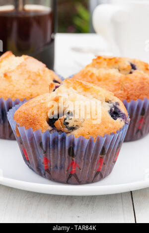 Blueberry Muffins and afternoon coffee in the garden - Stock Photo