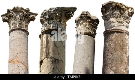 Collection of columns with capitals in Corinthian style isolated on white background. Ostia Antica, colony founded in the 7th century BC. Rome, Italy - Stock Photo