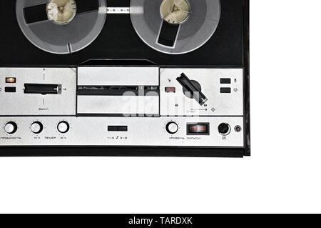 Vintage reel to reel tape recorder on isolated white background. Retro tape recorder from the Soviet Union - Stock Photo