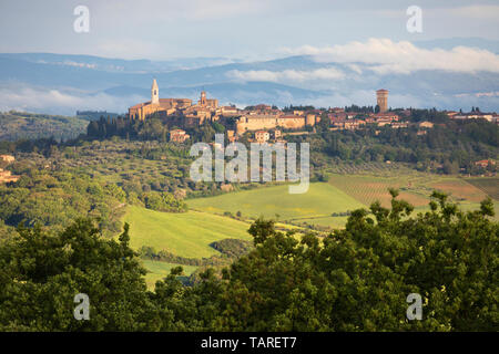 View over hilltop town of Pienza in early morning mist, Pienza, Siena Province, Tuscany, Italy, Europe - Stock Photo