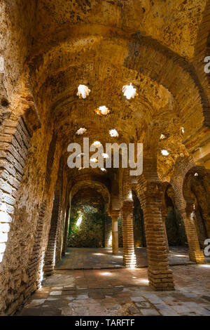 Ronda, Spain, April 05, 2018: The ruins of the Arab baths in town of Ronda, Andalusia, Spain - Stock Photo