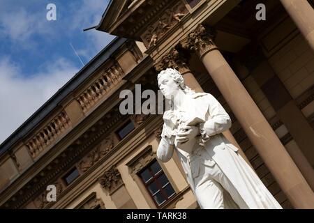 Friedrich Schiller memorial (Schillerdenkmal) outside of the Hessian State Theatre (Hessisches Staatstheater) in Wiesbaden, Germany. - Stock Photo