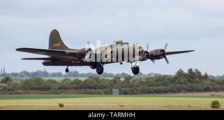 Boeing B-17 Flying Fortress G-BEDF taking off from Duxford Aerodrome - Stock Photo