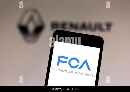 In this photo illustration the Fiat Chrysler Automobiles logo is seen displayed on a smartphone. - Stock Photo