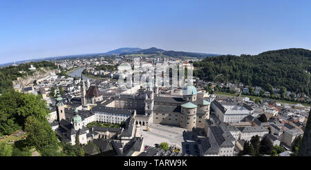 an aerial panoramic view of Salzburg old town from the castle at the riverside between the mountains - Stock Photo