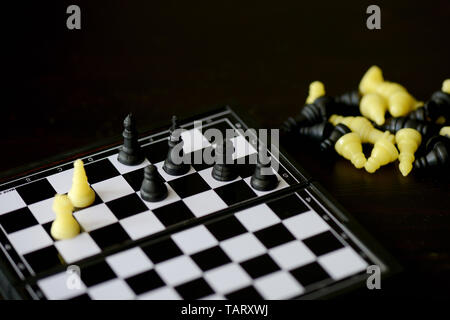 Travel Chess Set on a dark background close up - Stock Photo
