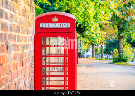 Traditional red telephone box on street of Hampstead Heath in London