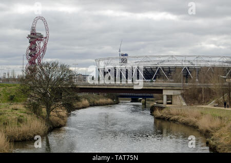 LONDON, UK - MARCH 19, 2016:  View along the River Lea towards the London Stadium and Orbit structure in Queen Elizabeth Olympic Park, Stratford. - Stock Photo