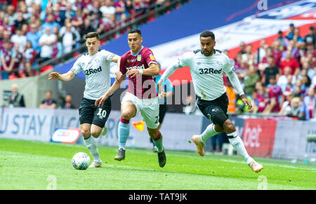 Anwar El Ghazi of Aston Villa gets between Tom Lawrence of Derby (left) and Tom Huddlestone of Derby during the EFL Sky Bet  Championship Play-Off Final match between Aston Villa and Derby County at Wembley Stadium , London , 27 May 2019 Editorial use only. No merchandising. For Football images FA and Premier League restrictions apply inc. no internet/mobile usage without FAPL license - for details contact Football Dataco - Stock Photo