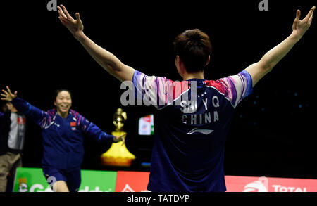 Shi Yuqi of China celebrates after defeating Kento Momota of Japan in their final group 1 match of Men's Singles during the TOTAL BWF Sudirman Cup 2019 at the Guangxi Sports Center Gymnasium in Nanning city, south China's Guangxi Zhuang Autonomous Region, 26 May 2019.  Shi Yuqi defeated Kento Momota 2-1 (15-21, 21-5, 21-11). - Stock Photo