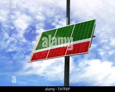Solar panels against a blue sky with a picture of the flag of Chechen Republic - Stock Photo