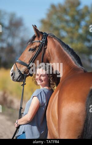 woman and Westphalian Horse - Stock Photo