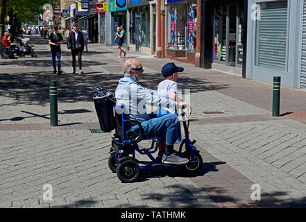 Disabled man on mobility scooter in Goole, East Yorkshire, England UK - Stock Photo