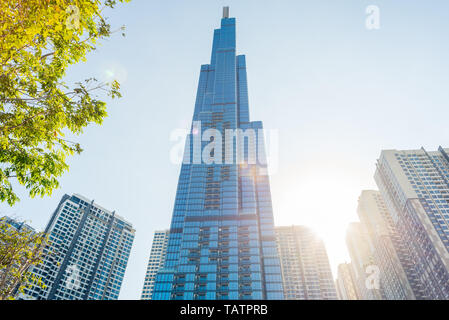 Ho Chi Minh City, Vietnam - February 19, 2019: Landmark 81 and other Vinhomes Central Park high-rise buildings, with the sun shining and lens flares.