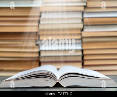 Book pages emit light. Symbol of wisdom, knowledge and learning. - Stock Photo