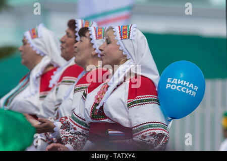 RUSSIA, Nikolskoe village, Republic of Tatarstan 25-05-2019: A group of mature women dancing traditional dance. A balloon with a name of Political Par - Stock Photo