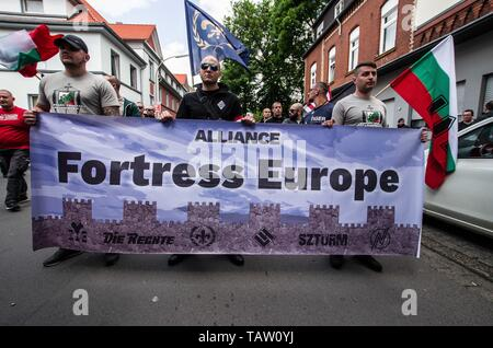 Dortmund, Nordrhein Westfalen, Germany. 25th May, 2019. The Alliance Fortress Europe banner being held by Bulgarian, French, German, and Hungarian neonazis in Dortmund, Germany. Prior to the European Elections, the neonazi party Die Rechte (The Right) organized a rally in the German city of Dortmund to promote their candidate, the incarcerated Holocaust denier Ursula Haverbeck. The demonstration and march were organized by prominent local political figure and neonazi activist Michael Brueck (Michael Brück) who enlisted the help of not only German neonazis, but also assistance from Russian, - Stock Photo
