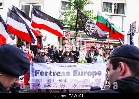 Dortmund, Nordrhein Westfalen, Germany. 25th May, 2019. The Alliance Fortress Europe consisting of German, French, Bulgarian, and Hungarian neonazis as seen in Dortmund, Germany. Prior to the European Elections, the neonazi party Die Rechte (The Right) organized a rally in the German city of Dortmund to promote their candidate, the incarcerated Holocaust denier Ursula Haverbeck. The demonstration and march were organized by prominent local political figure and neonazi activist Michael Brueck (Michael Brück) who enlisted the help of not only German neonazis, but also assistance from Russian, - Stock Photo