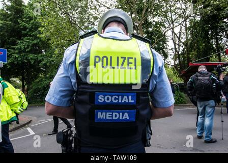 Dortmund, Nordrhein Westfalen, Germany. 25th May, 2019. A German police officer at a neonazi rally in Germany wears the identifiers that he is updating via their social networking platforms. Credit: Sachelle Babbar/ZUMA Wire/Alamy Live News - Stock Photo