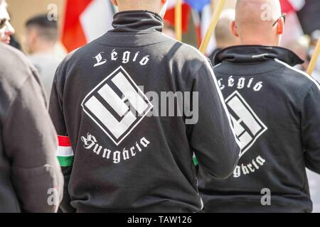 Dortmund, Nordrhein Westfalen, Germany. 25th May, 2019. Neonazis from the Legio Hungaria group as seen in Dortmund, Germany. Prior to the European Elections, the neonazi party Die Rechte (The Right) organized a rally in the German city of Dortmund to promote their candidate, the incarcerated Holocaust denier Ursula Haverbeck. The demonstration and march were organized by prominent local political figure and neonazi activist Michael Brueck (Michael Brück) who enlisted the help of not only German neonazis, but also assistance from Russian, Bulgarian, Hungarian, and Dutch groups with the final - Stock Photo