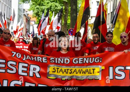 Dortmund, Nordrhein Westfalen, Germany. 25th May, 2019. Neonazis in Dortmund, Germany chant slogans through the streets of the city. Prior to the European Elections, the neonazi party Die Rechte (The Right) organized a rally in the German city of Dortmund to promote their candidate, the incarcerated Holocaust denier Ursula Haverbeck. The demonstration and march were organized by prominent local political figure and neonazi activist Michael Brueck (Michael Brück) who enlisted the help of not only German neonazis, but also assistance from Russian, Bulgarian, Hungarian, and Dutch groups with t - Stock Photo