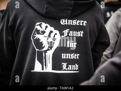 Dortmund, Nordrhein Westfalen, Germany. 25th May, 2019. ''Our fists for our land'' worn by a neonazi in Dortmund, Germany. Prior to the European Elections, the neonazi party Die Rechte (The Right) organized a rally in the German city of Dortmund to promote their candidate, the incarcerated Holocaust denier Ursula Haverbeck. The demonstration and march were organized by prominent local political figure and neonazi activist Michael Brueck (Michael Brück) who enlisted the help of not only German neonazis, but also assistance from Russian, Bulgarian, Hungarian, and Dutch groups with the final t - Stock Photo